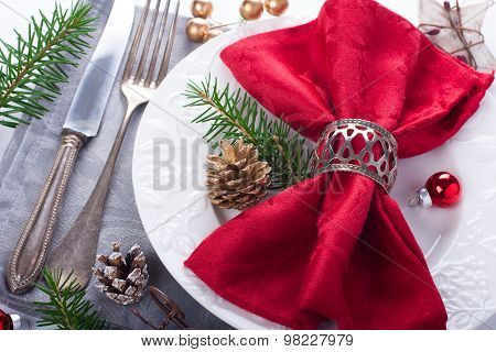 Christmas table place setting with decorations
