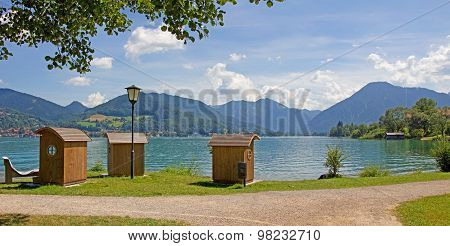 Idyllic Lake Tegernsee Beach With Wooden Beach Chairs