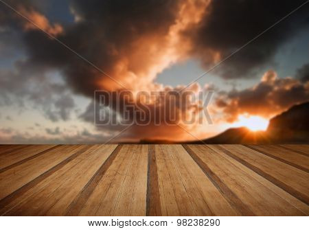 Sunrise And Mountains Refelcted In Sea With Wooden Planks Floor