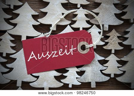 Red Christmas Label With Auszeit Means Downtime
