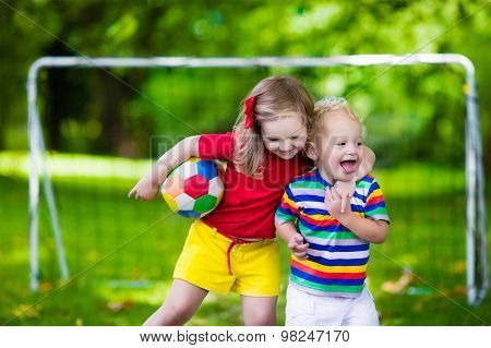 Kids Playing Football In A Park