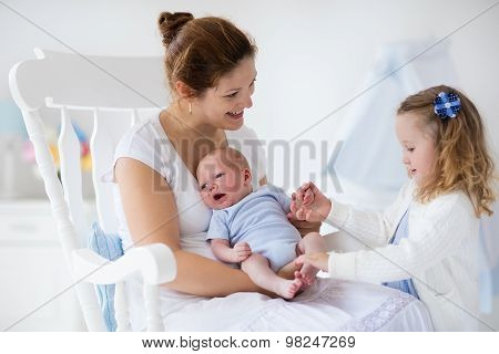 Mother With Newborn Baby And Toddler Daughter