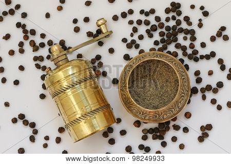 Brass pepper mill.