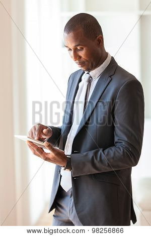 African American Business Man Using A Tactile Tablet -black People
