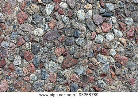 Textured Pebble Sidewalk Background.