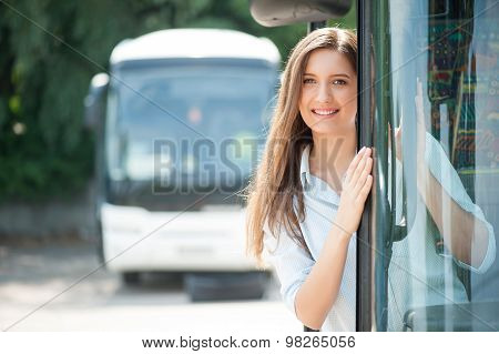 Attractive young woman is traveling in public transport