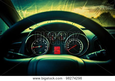 Modern Compact Car Dashboard Console and Steering Wheel Closeup. Rainy Weather. poster