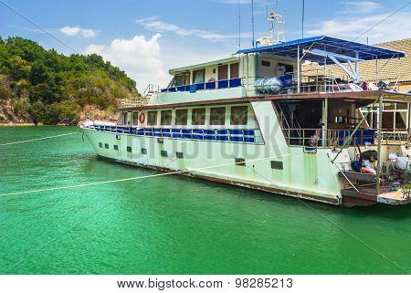 passenger ship floating at port.