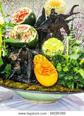 Cantaloupe, watermelon and papaya fruit carving.