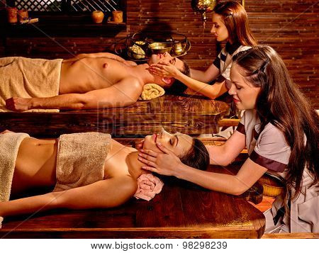 Couple  having oil Ayurveda spa treatment. Spa resorts in India
