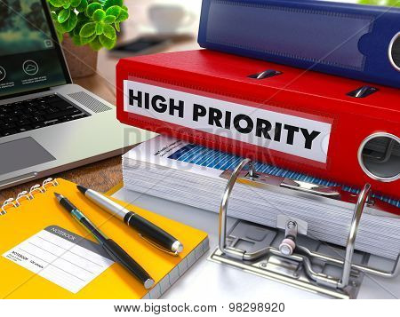 Red Ring Binder with Inscription High Priority.