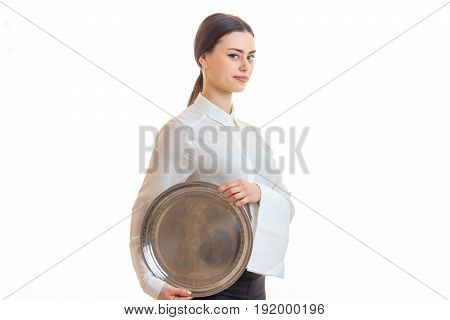 beautiful girl in uniform waiter with a tray in hands isolated on white background