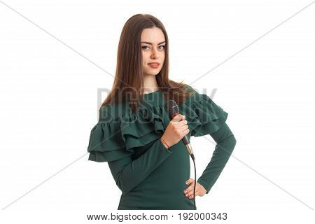 beautiful girl in a green dress with a microphone in hands isolated on white background