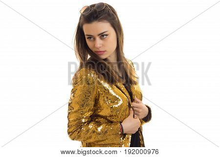 Cutie young brunette woman in golden jacket isolated on white background