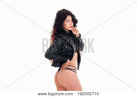 sexy woman in a string panties and leather jacket isolated on white background