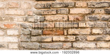Background texture of old vintage dirty brick wall with peeling plaster