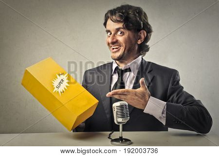 Businessman showing a product