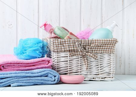Towels With Soap And Wisp On White Wooden Table