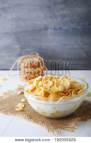 Cornflakes With Milk In Bowl On Wooden Table