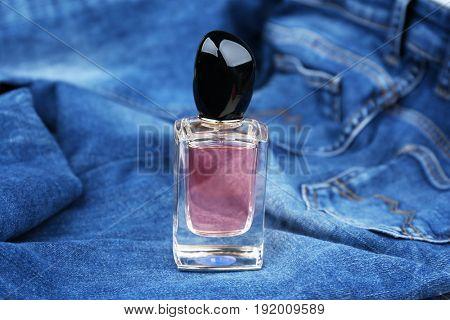 Perfume bottle on denim cloth