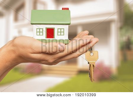 Holding model hand house key closeup business