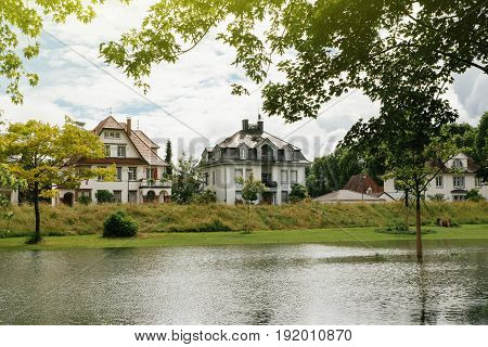German houses seen over flooded Rhine river at the border with France.