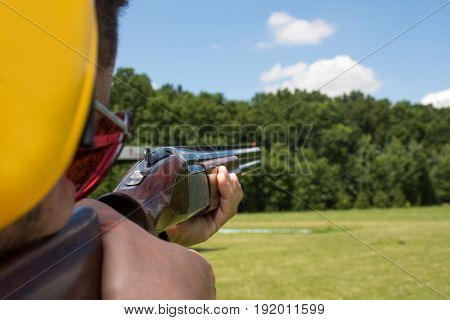 Man Shooting On An Outdoor Shooting Range