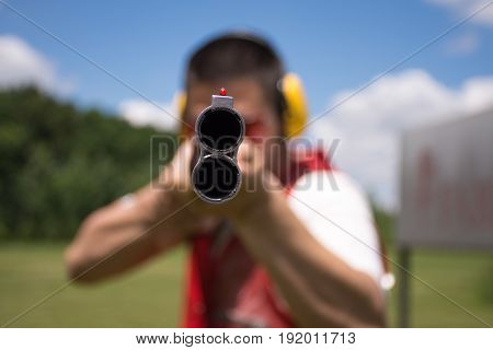 Man aiming shotgun at you. shooting, shot