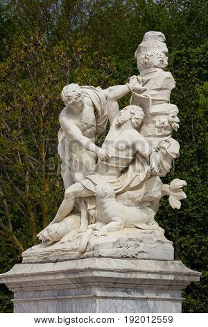 Versailles France - April 13 2014: Marble statue in the park of Palace of Versailles France
