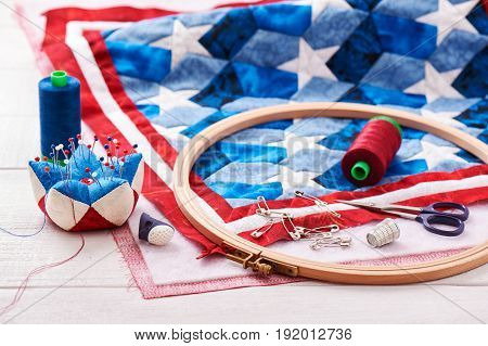 Quilt assembly with stylized elements of the American flag