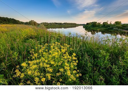 Evening Above The River At Summer With Cloudy Sky Background.