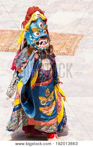 Unidentified Monk Performs A Religious Masked And Costumed Mystery Dance Of Tibetan Buddhism During