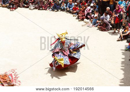 Unidentified Monk In Deer Mask Performs A Religious Masked And Costumed Mystery Dance Of Tibetan Bud