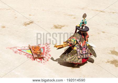 Lamayuru India - June 17, 2012: monk performs sacred costumed mystery