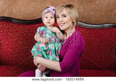 Portrait of a grandmother and her eight month old grandaughter