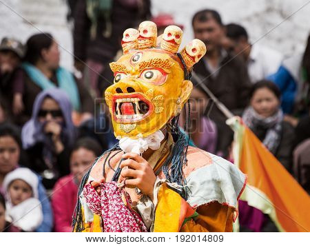 Lamayuru India - June 17: unidentified monk performs a religious masked and costumed mystery dance of Tibetan Buddhism during the Cham Dance Festival on June 17 2012 in Lamayuru monastery India.