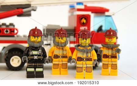 Colorado, USA - June 14, 2017: Studio shot of cute LEGO minifigure firemen and fire engine isolated on white background.