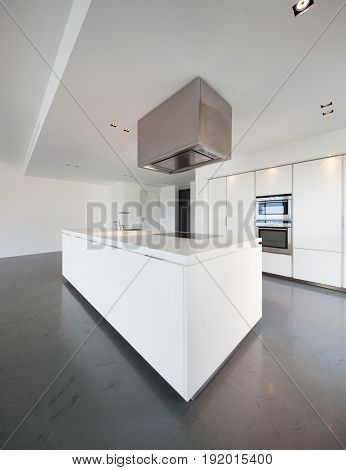 View of white kitchen in modern apartment. Nobody inside