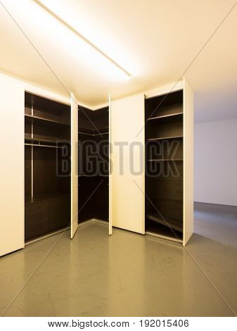White wardrobe.  Shutter are open. nobody inside