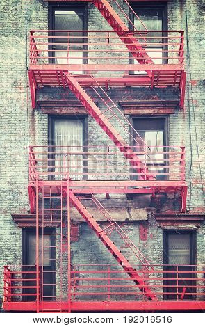 Retro Stylized Photo Of Red Fire Escape In Manhattan, New York City, Usa.