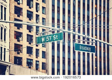 West 57 Street And Broadway Hanging Signs In Manhattan, Nyc.