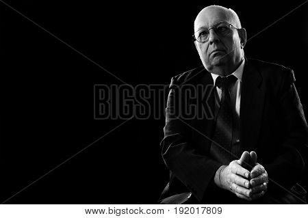 Business And People Concept - Close Up Of Senior Businessman In Eyeglasses And Suit