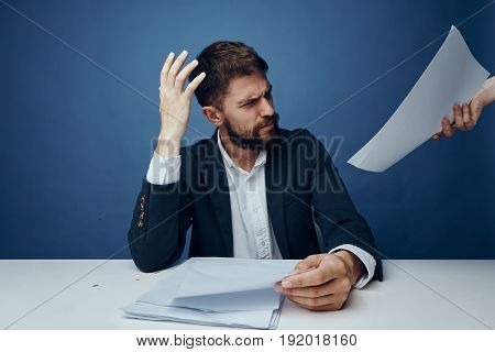 Surprised business man, businessman with documents, businessman on blue background.