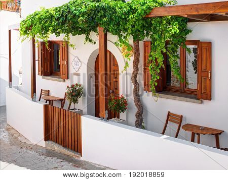 RHODES ISLAND, GREECE, JUN 25, 2015: View on Greek white villa Panthea for tourists and guests. Classical Greek hotel architecture. Greece island holidays tours travel journey vacation