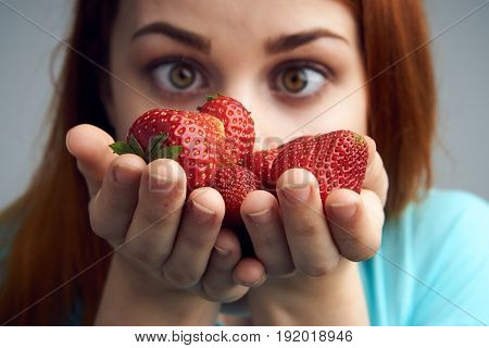 Woman with strawberry, sweet, juicy, tasty, woman on gray background.