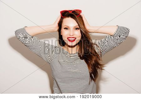 High fashion look. glamor stylish beautiful young happy smiling woman model with red sunglasses