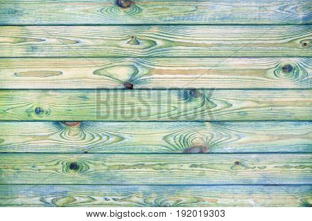 Light blue and green wooden background, old scratched wood