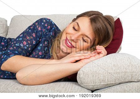 Picture of a beautiful young woman lying on the couch at home indoor