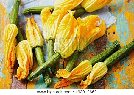 Edible bright yellow zucchini flowers isolated with baby courgette