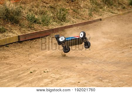Radio Controlled Car Model In Race On Dirt Track